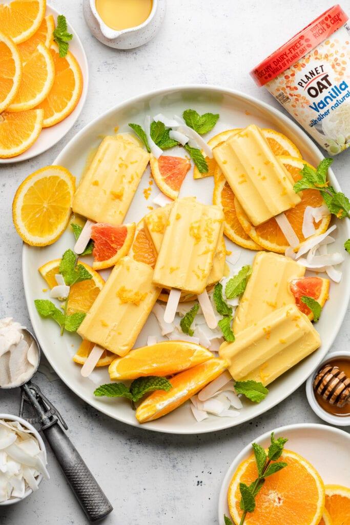 orange popsicles on a platter
