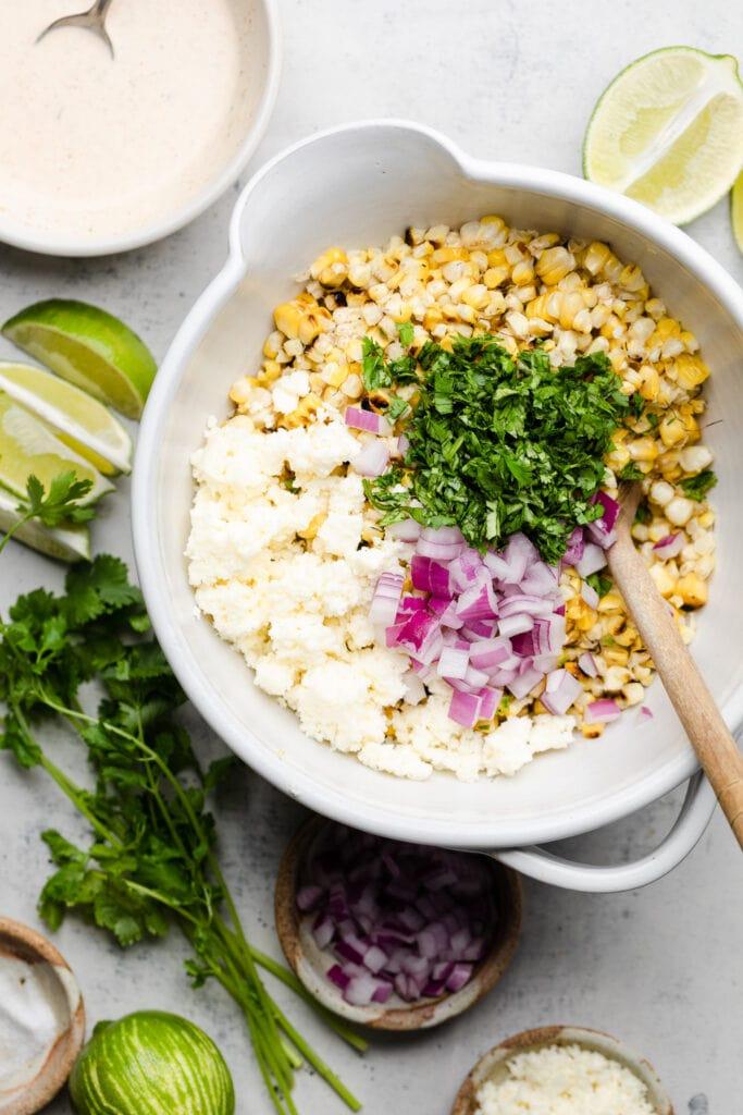 street corn salad ingredients in a bowl