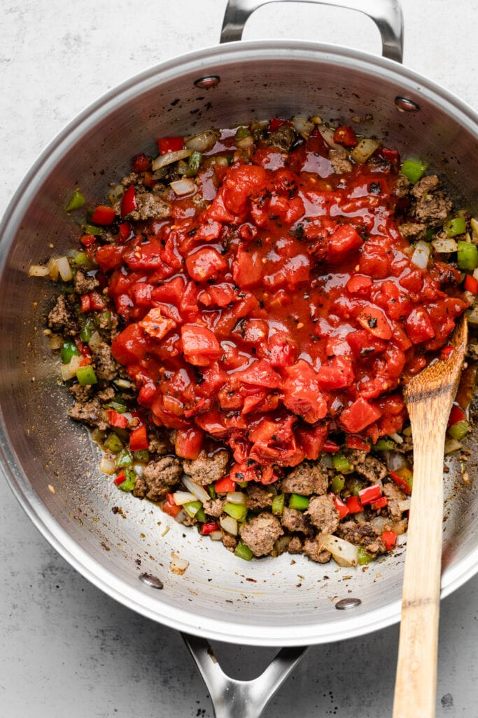 tomatoes in pot with ground beef and veggies