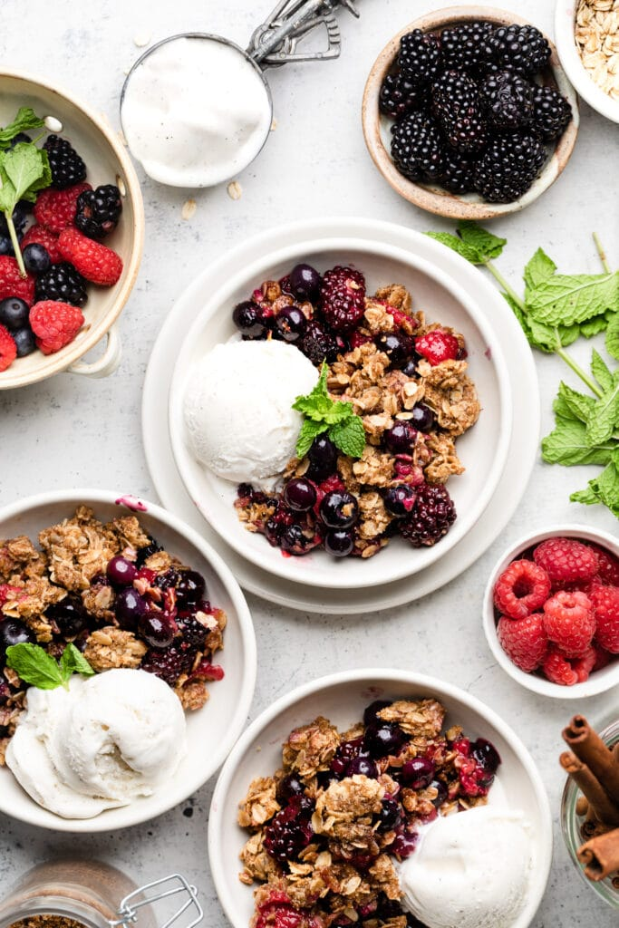triple berry crisp with ice cream in a bowl