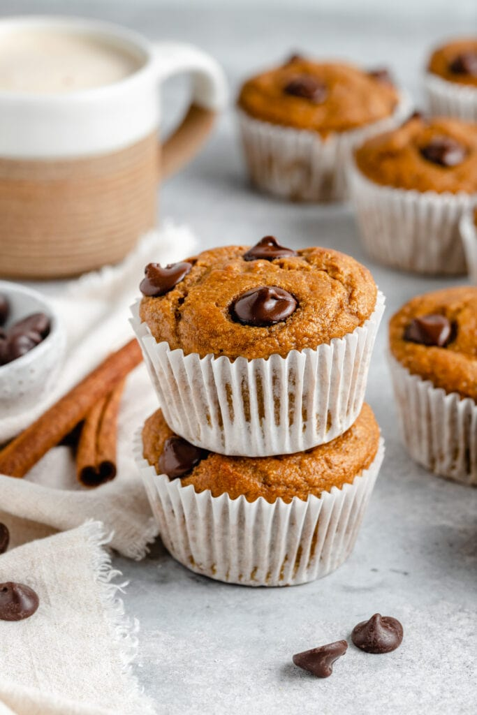 healthy pumpkin banana muffins stacked on each other