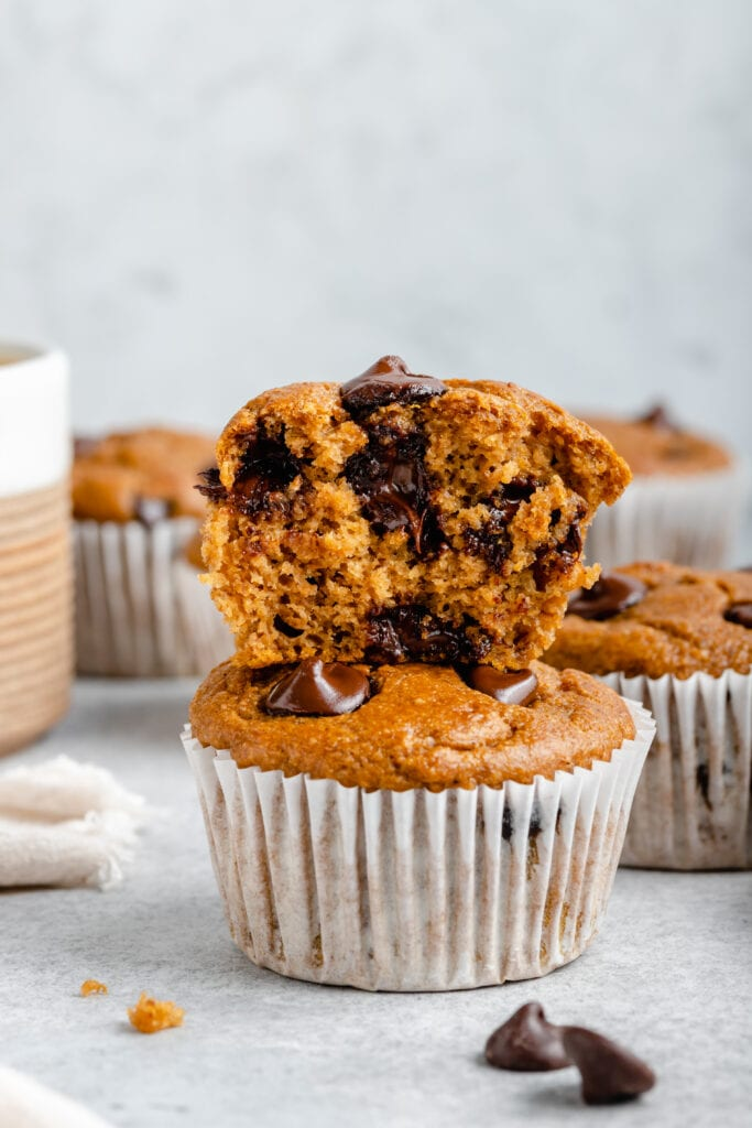 pumpkin banana muffins stacked on top of each other